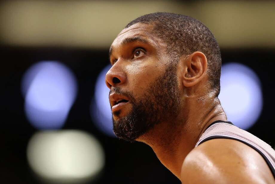Tim Duncan of the Spurs looks to the basket against the Phoenix Suns at US Airways Center on Feb. 24, 2013 in Phoenix. Photo: Christian Petersen, Getty Images / 2013 Getty Images