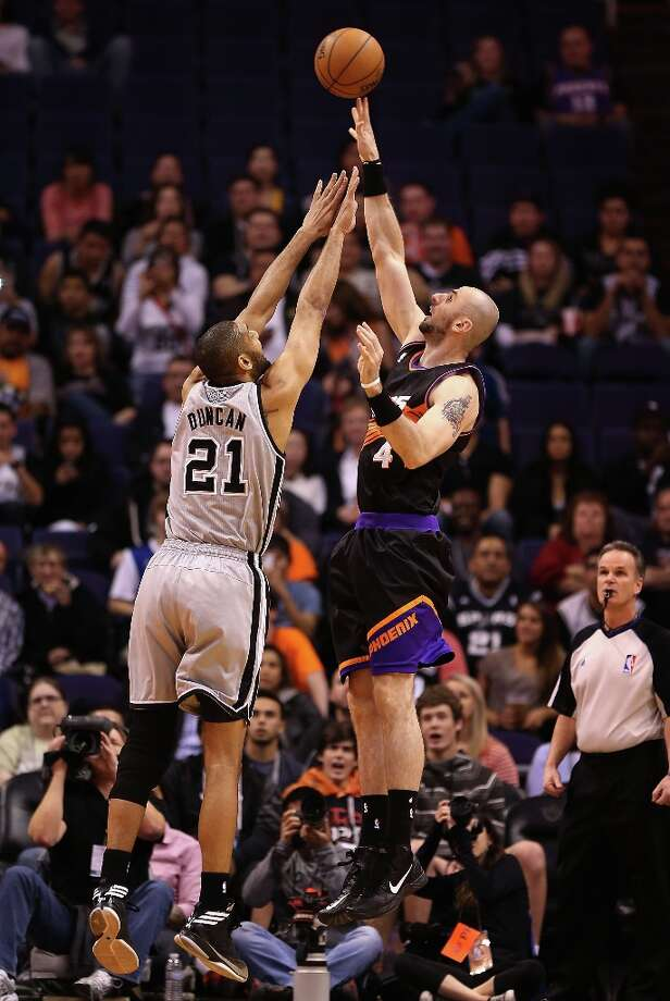 Marcin Gortat #4 of the Suns puts up a shot over Tim Duncan #21 of the Spurs during the first half at US Airways Center on Feb. 24, 2013 in Phoenix. Photo: Christian Petersen, Getty Images / 2013 Getty Images