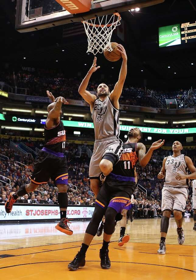 Manu Ginobili #20 of the Spurs drives to the basket against Markieff Morris #11 of the Suns during the first half at US Airways Center on Feb. 24, 2013 in Phoenix. Photo: Christian Petersen, Getty Images / 2013 Getty Images