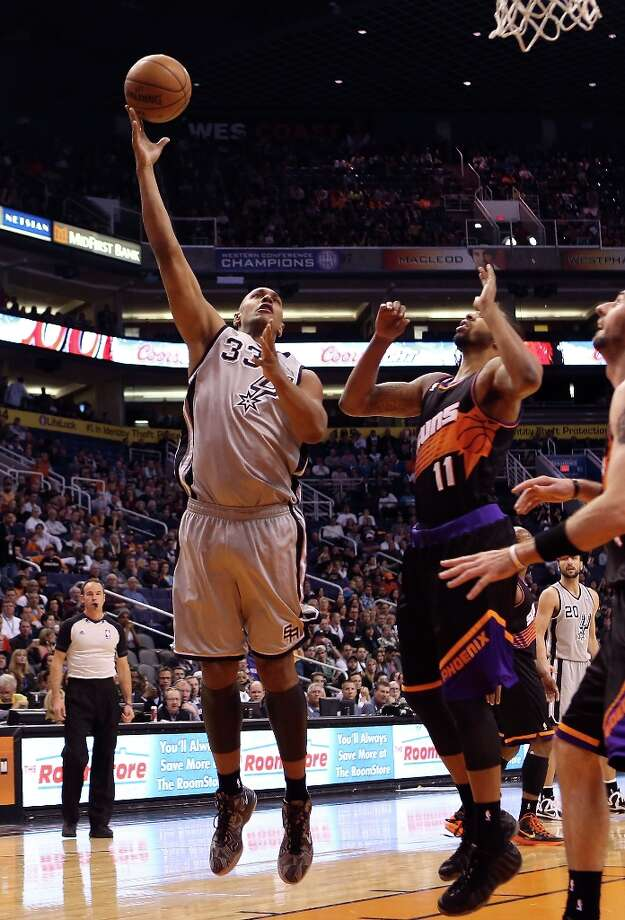 Boris Diaw #33 of the Spurs puts up a shot over Markieff Morris #11 of the Suns during the first half at US Airways Center on Feb. 24, 2013 in Phoenix. Photo: Christian Petersen, Getty Images / 2013 Getty Images