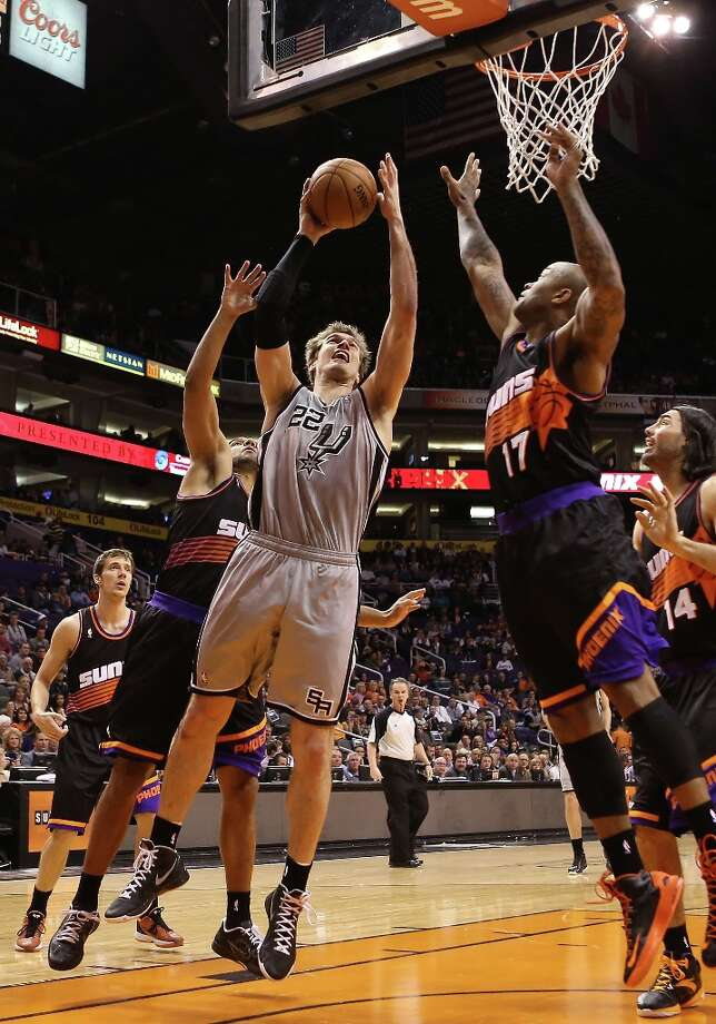 Tiago Splitter #22 of the Spurs attempts a shot against P.J. Tucker #17 of the Suns during the first half at US Airways Center on Feb. 24, 2013 in Phoenix. Photo: Christian Petersen, Getty Images / 2013 Getty Images