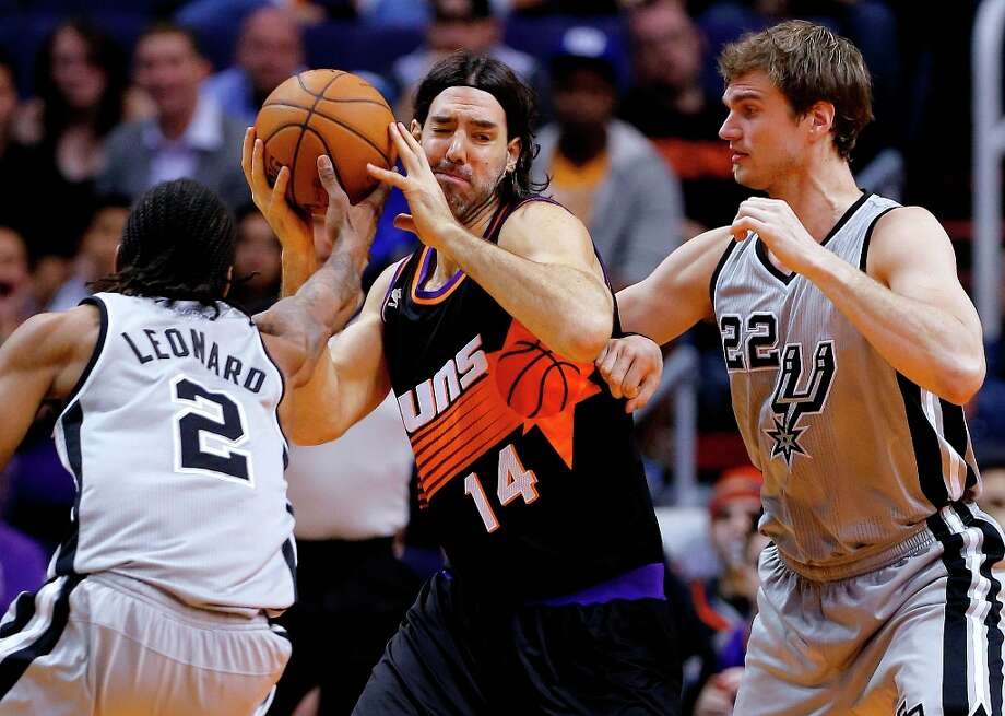 The Spurs' Kawhi Leonard (2) and Tiago Splitter (22), pressure the Suns' Luis Scola (14) during the first half Sunday, Feb. 24, 2013, in Phoenix. Photo: Matt York, Associated Press / AP