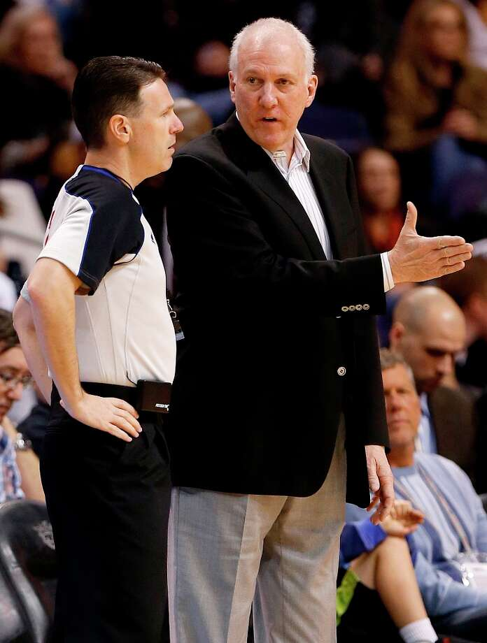 Spurs coach Gregg Popovich talks with referee Pat Fraher during the first half against the Suns, Sunday, Feb. 24, 2013, in Phoenix. Photo: Matt York, Associated Press / AP