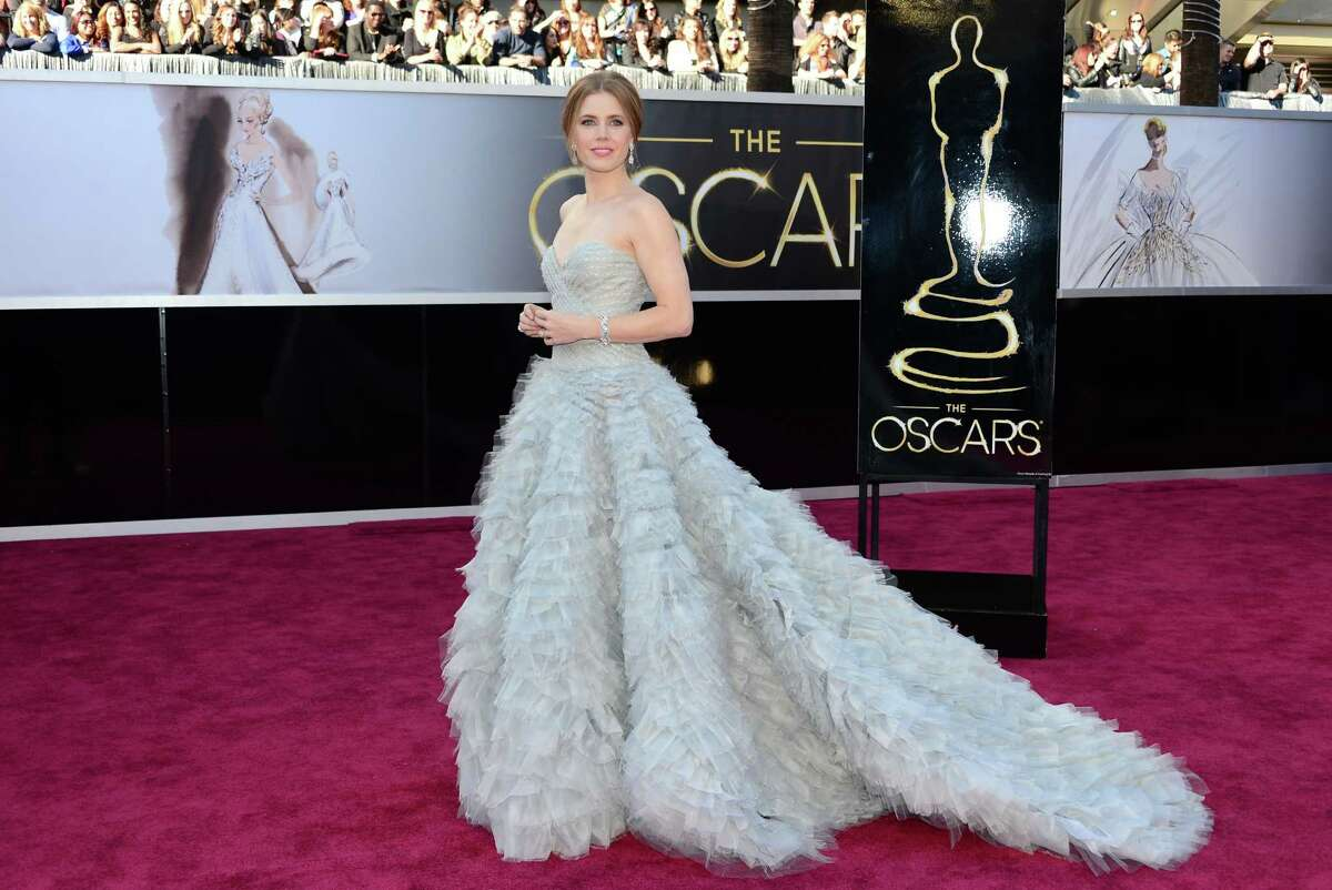 Best Supporting Actress nominee Amy Adams in Oscar de la Renta. AFP PHOTO/FREDERIC J. BROWNFREDERIC J. BROWN/AFP/Getty Images