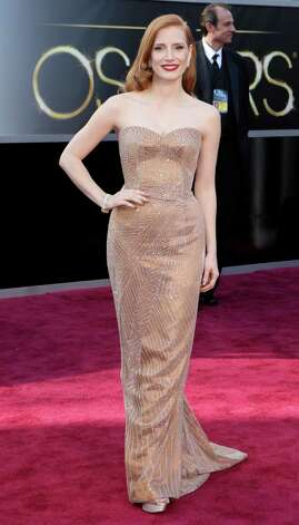 "Jessica Chastain, wearing Giorgio Armani, arrives at the 85th Academy Awards ceremony at the Dolby Theatre in Los Angeles, Feb. 24, 2013. Chastain is nominated for best actress in a leading role for ""Zero Dark Thirty."" (Josh Haner/The New York Times) Photo: JOSH HANER, STF / NYTNS"