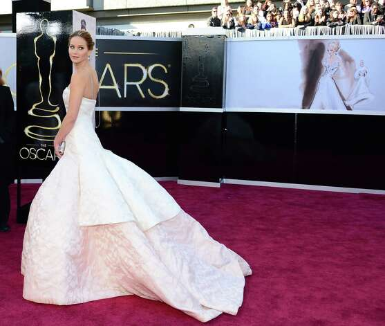 Jennifer Lawrence looked elegant in her Dior gown, but tripped on the way up to accept her Best Actress Oscar. Photo: FREDERIC J. BROWN, Staff / AFP