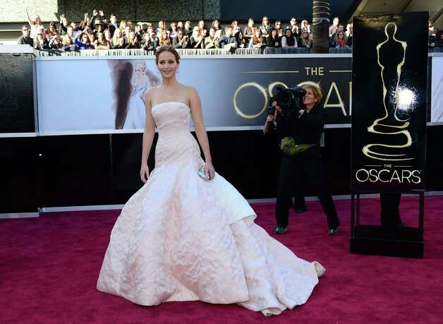Best Actress nominee Jennifer Lawrence arrives on the red carpet for the 85th Annual Academy Awards on February 24, 2013 in Hollywood, California. AFP PHOTO/FREDERIC J. BROWNFREDERIC J. BROWN/AFP/Getty Images Photo: FREDERIC J. BROWN, Staff / AFP