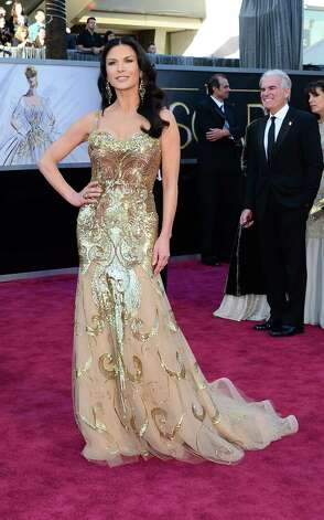 Actress Catherine Zeta Jones arrives on the red carpet for the 85th Annual Academy Awards on February 24, 2013 in Hollywood, California. AFP PHOTO/FREDERIC J. BROWNFREDERIC J. BROWN/AFP/Getty Images Photo: FREDERIC J. BROWN, Staff / AFP