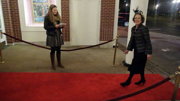 "Lynne Fife lights up the night walking the red carpet as she arrives for the Avon Theatre's annual Oscar party at the theatre on Bedford Street in Stamford, Conn., Feb. 24, 2013. Guests got to walk a red carpet as they arrive to the event which included several James Bond features in celebration of the 50th anniversary of Bond films. A ""Bond Girl"" strolled the party in a bikini modeled after Ursula Andress in the first Bond film, Dr. No. Photo: Keelin Daly / Keelin Daly"