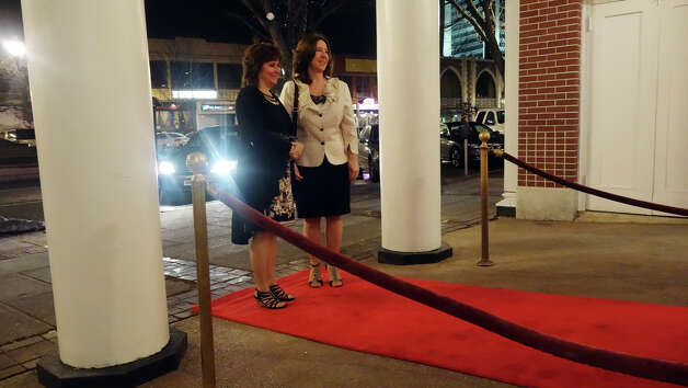 "Darlene Mocci and Marsha Silva walk the red carpet as they arrive at the Avon Theatre's annual Oscar party at the theatre on Bedford Street in Stamford, Conn., Feb. 24, 2013. Guests got to walk a red carpet as they arrive to the event which included several James Bond features in celebration of the 50th anniversary of Bond films. A ""Bond Girl"" strolled the party in a bikini modeled after Ursula Andress in the first Bond film, Dr. No. Photo: Keelin Daly / Keelin Daly"