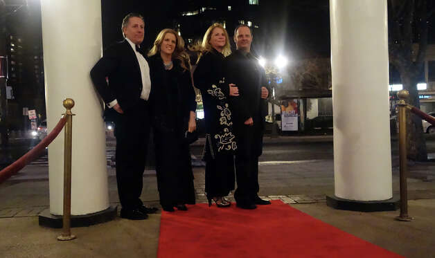 "The Avon Theatre's annual Oscar party at the theatre on Bedford Street in Stamford, Conn., Feb. 24, 2013. Guests got to walk a red carpet as they arrive to the event which included several James Bond features in celebration of the 50th anniversary of Bond films. A ""Bond Girl"" strolled the party in a bikini modeled after Ursula Andress in the first Bond film, Dr. No. Photo: Keelin Daly / Keelin Daly"