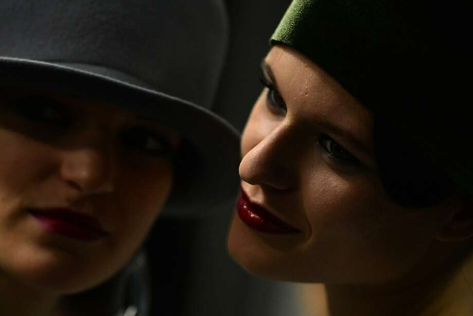 Models get ready backstage during the Emporio Armani Fall-Winter 2013-2014 Womenswear collection on February 24, 2013 during the Women's fashion week in Milan.  Photo: Gabriel Bouys, AFP/Getty Images