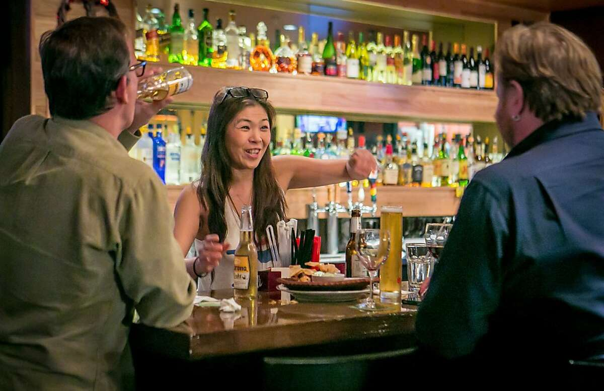 Bartender Pui Viwattanasakpol helps customers at Coconut Bay Restaurant in Burlingame, Calif. on Friday, February 15th, 2013.