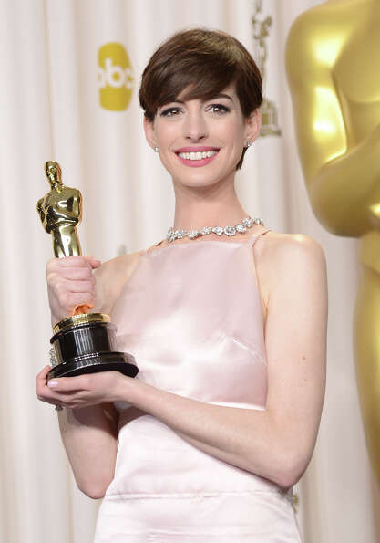 Actress Anne Hathaway, winner of the Best Supporting Actress award for Les Miserables, poses in the