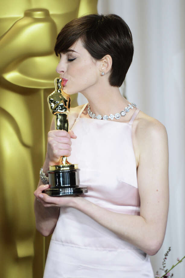 HOLLYWOOD, CA - FEBRUARY 24:  Actress Anne Hathaway poses in the press room during the Oscars at Loews Hollywood Hotel on February 24, 2013 in Hollywood, California. Photo: Jeff Kravitz, FilmMagic / 2013 Jeff Kravitz