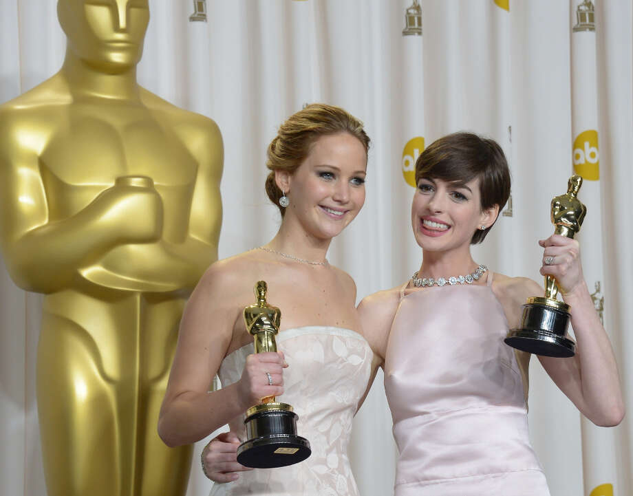 Best Actress Jennifer Lawrence (L) stands with  Best Supporting Actress Anne Hathaway (R)  during the 85th  Academy Awards on February 24, 2013 in Hollywood, California. AFP PHOTO / Joe KLAMAR Photo: JOE KLAMAR, AFP/Getty Images / 2013 AFP