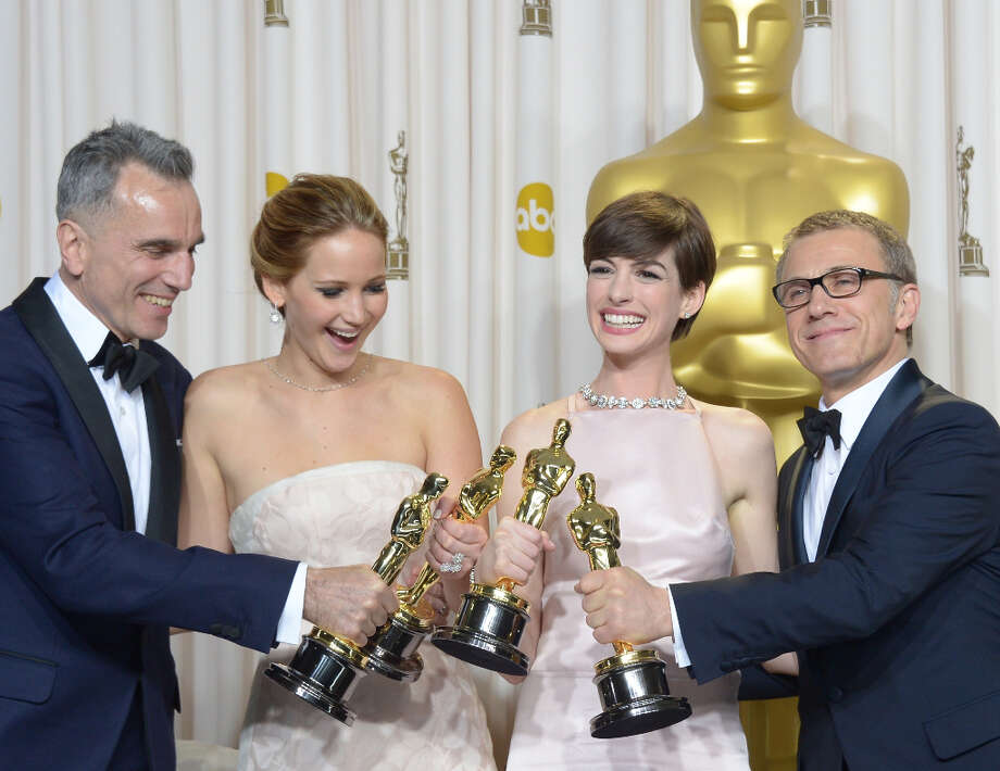 (L-R): Best Actor Daniel Day-Lewis stands with Best Actress  Jennifer Lawrence, Best Supporting Actress Anne Hathaway, and Best Supporting Actor Christoph Waltz  during the 85th  Academy Awards on February 24, 2013 in Hollywood, California. AFP PHOTO / Joe KLAMAR Photo: JOE KLAMAR, AFP/Getty Images / 2013 AFP