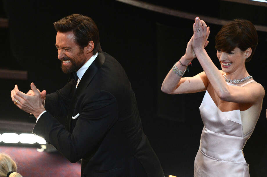 Best Actor nominee Hugh Jackman (l) and Best Supporting Actress winner Anne Hathaway react in the audience at the 85th Annual Academy Awards on February 24, 2013 in Hollywood, California. AFP PHOTO/Robyn BECK Photo: ROBYN BECK, AFP/Getty Images / 2013 AFP