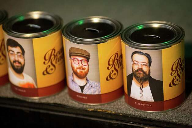 Donation cans for bearded - and competing - folk sit on display at the kickoff of the fifth annual Beard and Stache Fest on Sunday, Feb. 24, 2013, at Hilliard's Beer in Seattle, Wash. The night's events kicked off a month-long competition featuring over 100 furry-faced men. All donations benefited foster children in King County. Photo: JORDAN STEAD / SEATTLEPI.COM