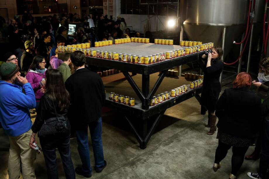 Attendees view donation cans, seeking their bearded competitor of choice at the kickoff of the fifth annual Beard and Stache Fest on Sunday, Feb. 24, 2013, at Hilliard's Beer in Seattle, Wash. The night's events kicked off a month-long competition featuring over 100 furry-faced men. All donations benefited foster children in King County. Photo: JORDAN STEAD / SEATTLEPI.COM