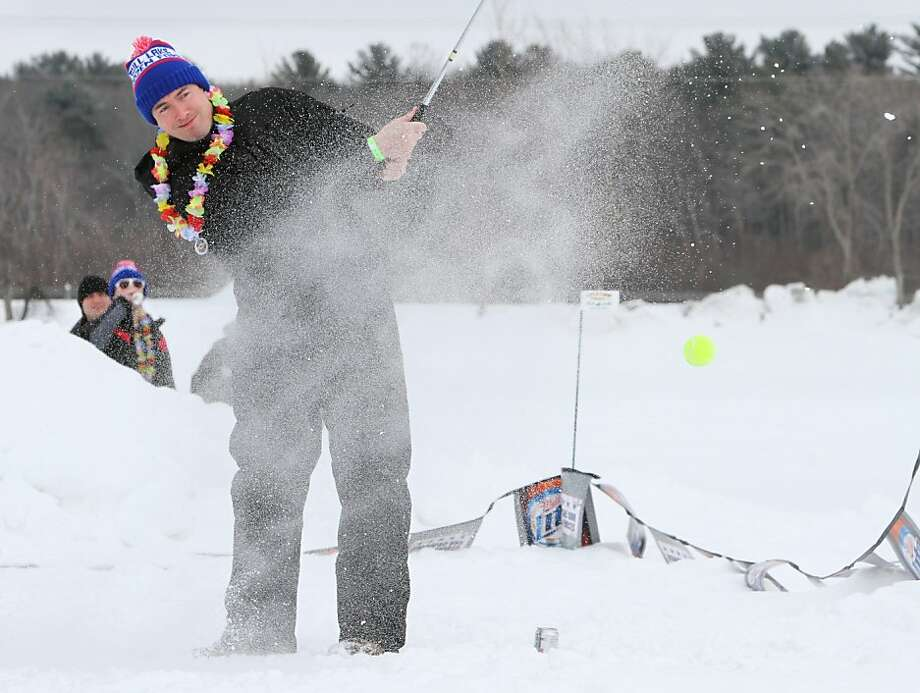Golfers try their hand at snow golf, Saturday, Feb. 23, 2013, on Hole-in-the-Day Bay during the annual Gull Lake Frozen Fore in Nisswa, Minn.  Photo: Kelly Humphrey, Associated Press