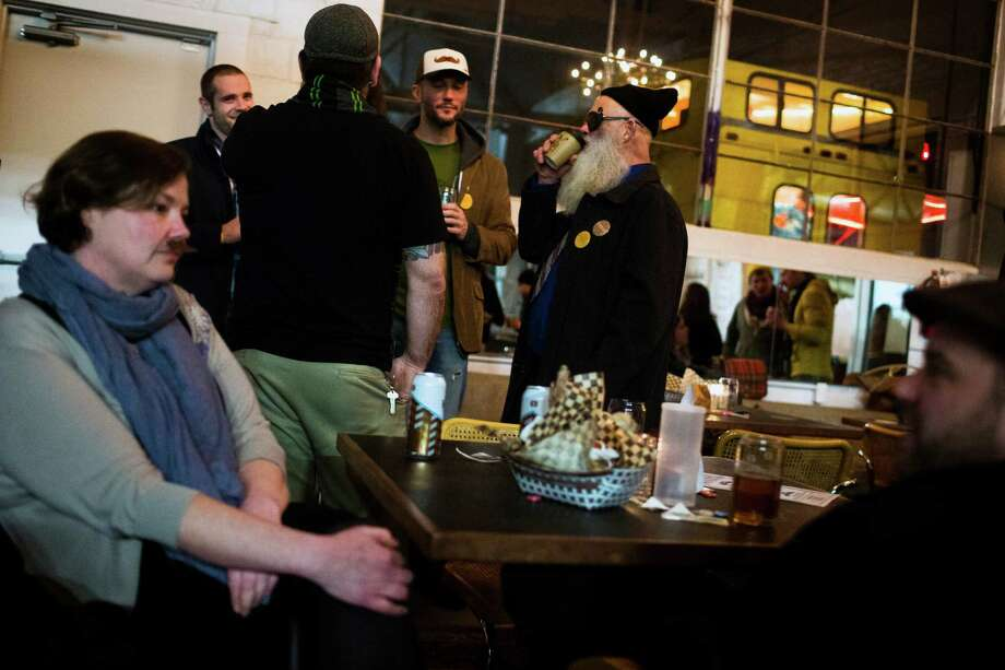 Attendees enjoy company and cold Hilliard's beer at the kickoff of the fifth annual Beard and Stache Fest on Sunday, Feb. 24, 2013, at Hilliard's Beer in Seattle, Wash. The night's events kicked off a month-long competition featuring over 100 furry-faced men. All donations benefited foster children in King County. Photo: JORDAN STEAD / SEATTLEPI.COM