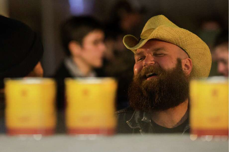 Competitor Josh Dand, right, laughs with a friend at the kickoff of the fifth annual Beard and Stache Fest on Sunday, Feb. 24, 2013, at Hilliard's Beer in Seattle, Wash. Although the event raised over 17,000 dollars last year, Dand is determined to have this year's net over 25,000 dollars. The night's events kicked off a month-long competition featuring over 100 furry-faced men. All donations benefited foster children in King County. Photo: JORDAN STEAD / SEATTLEPI.COM