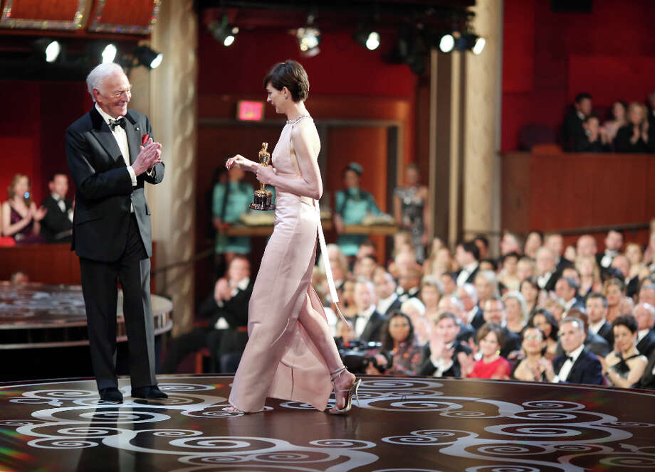 HOLLYWOOD, CA - FEBRUARY 24:  Actress Anne Hathaway (R) accepts the Best Supporting Actress award for Les Miserables from presenter Christopher Plummer (L), seen from backstage during the Oscars held at the Dolby Theatre on February 24, 2013 in Hollywood, California. Photo: Christopher Polk, Getty Images / 2013 Getty Images