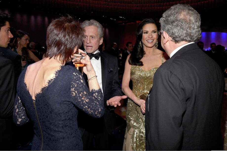 Actor Michael Douglas (L) and actress Catherine Zeta-Jones attend the Oscars Governors Ball at Hollywood & Highland Center on February 24, 2013 in Hollywood, California. Photo: Kevork Djansezian, Getty Images / 2013 Getty Images
