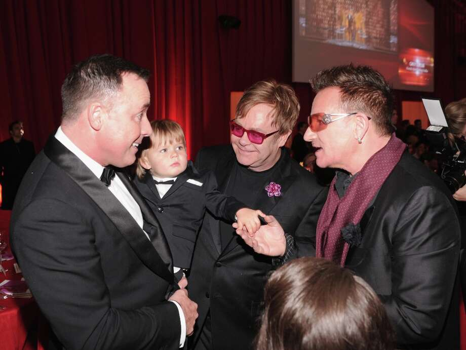 David Furnish, Zachary Furnish-John, Sir Elton John and Bono attend the 21st Annual Elton John AIDS Foundation Academy Awards Viewing Party at Pacific Design Center on February 24, 2013 in West Hollywood, California. Photo: Jamie McCarthy, Getty Images For EJAF / 2013 Getty Images