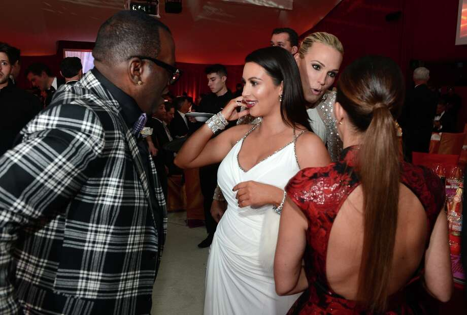 (L-R) TV Personalities Randy Jackson and Kim Kardashian, actress/model Molly Sims and tv personality Kourtney Kardashian attend the 21st Annual Elton John AIDS Foundation Academy Awards Viewing Party at Pacific Design Center on February 24, 2013 in West Hollywood, California. Photo: Dimitrios Kambouris, Getty Images For EJAF / 2013 Getty Images