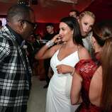 (L-R) TV Personalities Randy Jackson and Kim Kardashian, actress/model Molly Sims and tv personality Kourtney Kardashian attend the 21st Annual Elton John AIDS Foundation Academy Awards Viewing Party at Pacific Design Center on February 24, 2013 in West Hollywood, California.