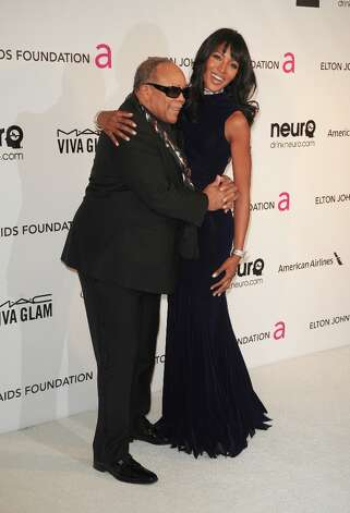 Musician Quincy Jones and model Naomi Campbell arrive for the 21st Annual Elton John AIDS Foundation's Oscar Viewing Party  February 24, 2013 in Hollywood, California. AFP PHOTO/Mehdi TAAMALLAHMEHDI TAAMALLAH/AFP/Getty Images Photo: MEHDI TAAMALLAH, AFP/Getty Images / AFP