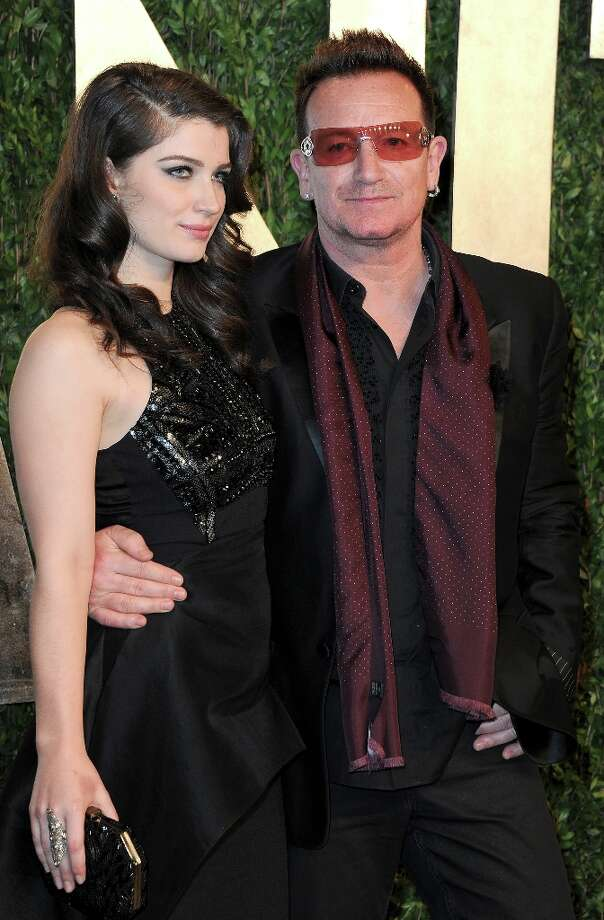 Singer Bono (R) and actress Eve Hewson arrive at the 2013 Vanity Fair Oscar Party hosted by Graydon Carter at Sunset Tower on February 24, 2013 in West Hollywood, California. Photo: Pascal Le Segretain, Getty Images / 2013 Getty Images