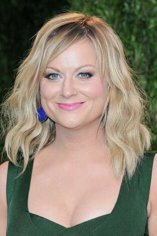 Actress Amy Poehler arrives at the 2013 Vanity Fair Oscar Party hosted by Graydon Carter at Sunset Tower on February 24, 2013 in West Hollywood, California. Photo: Pascal Le Segretain, Getty Images / 2013 Getty Images