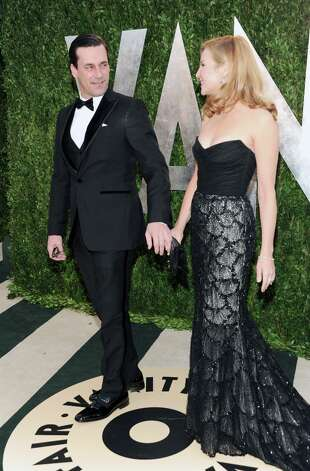Actor Jon Hamm, left, and partner, actress Jennifer Westfeldt arrive at the 2013 Vanity Fair Oscars Viewing and After Party, Sunday, Feb. 24 2013 at the Sunset Plaza Hotel in West Hollywood, Calif. (Photo by Evan Agostini/Invision/AP) Photo: Evan Agostini, Associated Press / Invision