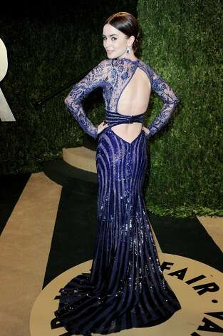 Actress Lily Collins arrives at the 2013 Vanity Fair Oscar Party hosted by Graydon Carter at Sunset Tower on February 24, 2013 in West Hollywood, California. Photo: Pascal Le Segretain, Getty Images / 2013 Getty Images
