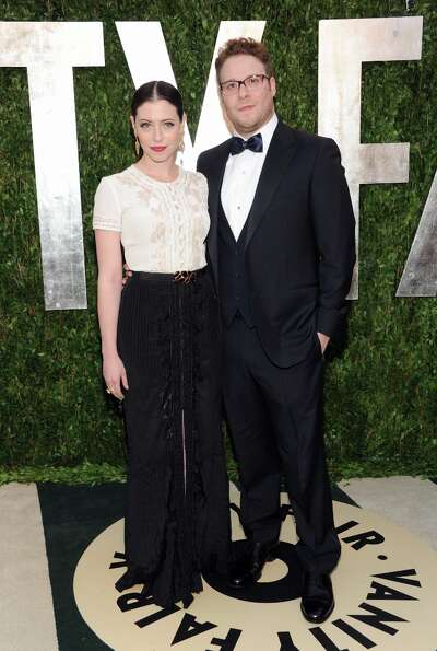 Actor Seth Rogen, right, and wife Lauren Miller arrive at the 2013 Vanity Fair Oscars Viewing and Af