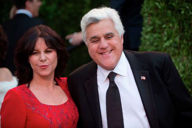 Jay Leno and his wife arrive for the 2013 Vanity Fair Oscar Party on February 24, 2013 in Hollywood, California. AFP PHOTO/ADRIAN SANCHEZ-GONZALEZ Photo: ADRIAN SANCHEZ-GONZALEZ, AFP/Getty Images / AFP