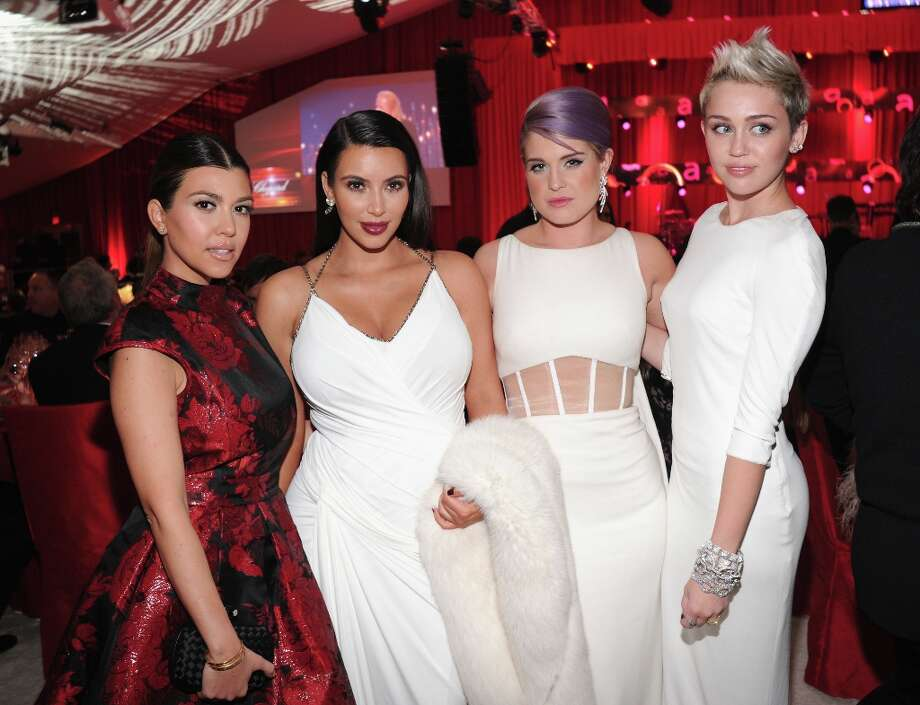 (L-R) TV personalities Kourtney Kardashian, Kim Kardashian and Kelly Osbourne and actress/singer Miley Cyrus attend the 21st Annual Elton John AIDS Foundation Academy Awards Viewing Party at Pacific Design Center on February 24, 2013 in West Hollywood, California. Photo: Jamie McCarthy, Getty Images For EJAF / 2013 Getty Images