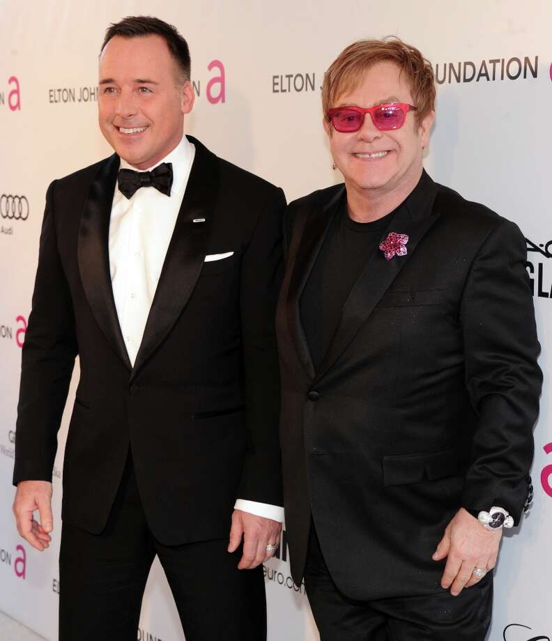 (L-R) David Furnish and Sir Elton John attend the 21st Annual Elton John AIDS Foundation Academy Awards Viewing Party at Pacific Design Center on February 24, 2013 in West Hollywood, California. Photo: Jamie McCarthy, Getty Images For EJAF / 2013 Getty Images