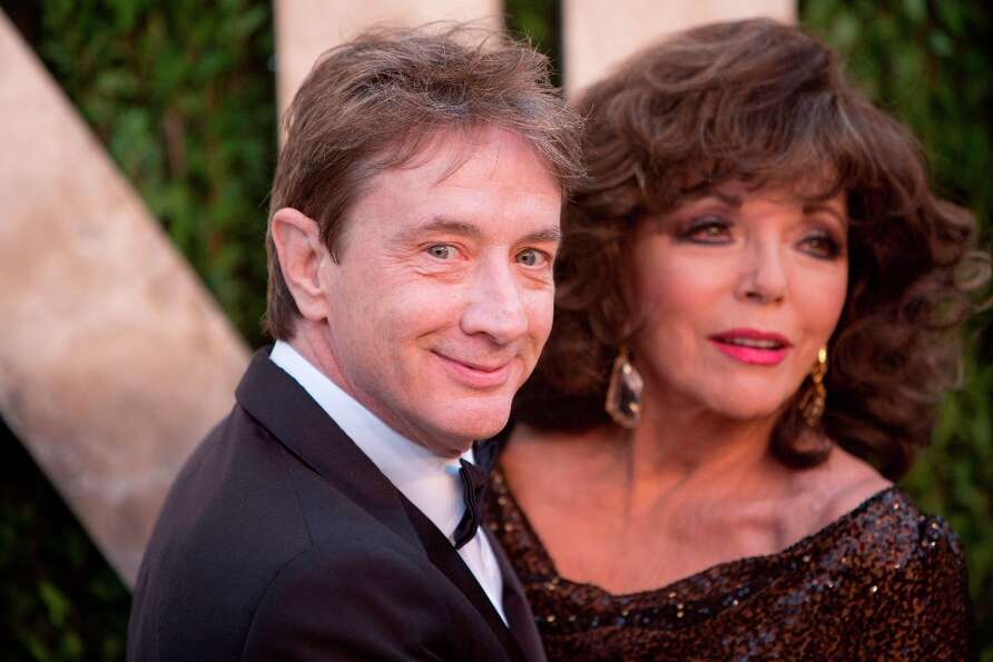 Martin Short and Joan Collins arrive for the 2013 Vanity Fair Oscar Party on February 24, 2013 in Ho