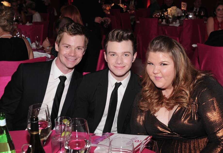 Chris Colfer (C), Ashley Fink (R) and guest attends the 21st Annual Elton John AIDS Foundation Academy Awards Viewing Party at Pacific Design Center on February 24, 2013 in West Hollywood, California. Photo: Jamie McCarthy, Getty Images For EJAF / 2013 Getty Images