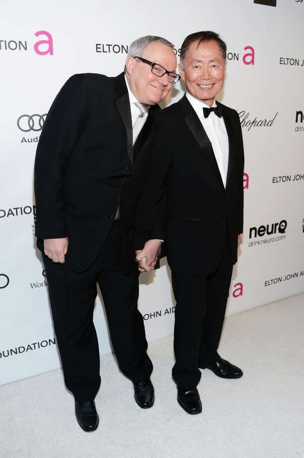 Actor George Takei (R) and Brad Altman attend the 21st Annual Elton John AIDS Foundation Academy Awards Viewing Party at Pacific Design Center on February 24, 2013 in West Hollywood, California. Photo: Jason Kempin, Getty Images For EJAF / 2013 Getty Images