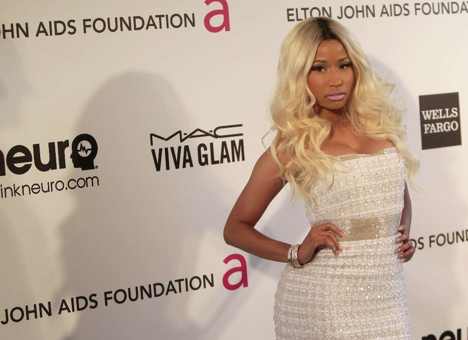 Singer Nicki Minaj arrives for the 21st Annual Elton John AIDS Foundation's Oscar Viewing Party on February 24, 2013 in Hollywood, California. AFP PHOTO/Mehdi TAAMALLAHMEHDI TAAMALLAH/AFP/Getty Images Photo: MEHDI TAAMALLAH, AFP/Getty Images / AFP