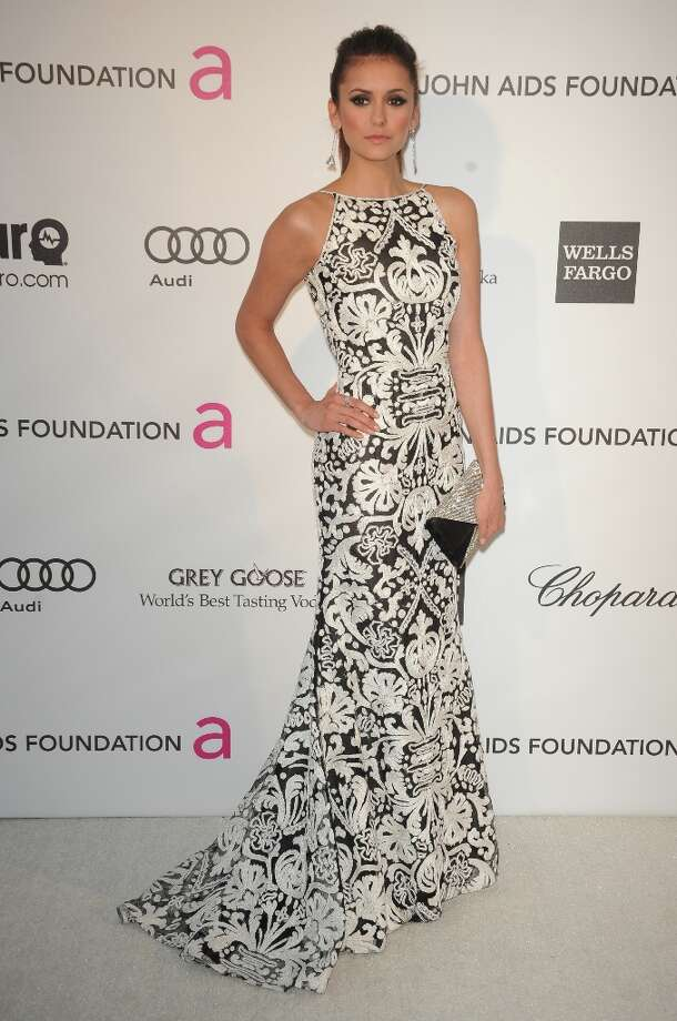 Actress Nina Dobrev arrives for the 21st Annual Elton John AIDS Foundation's Oscar Viewing Party  February 24, 2013 in Hollywood, California. AFP PHOTO / Mehdi TAAMALLAHMehdi TAAMALLAH/AFP/Getty Images Photo: MEHDI TAAMALLAH, AFP/Getty Images / AFP