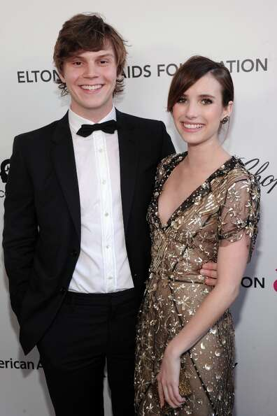 WEST HOLLYWOOD, CA - FEBRUARY 24: (L-R) Actors Evan Peters and Emma Roberts attend the 21st Annual E