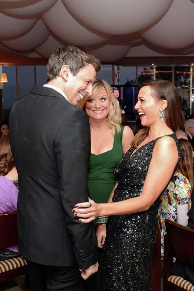 Actors Seth Meyers, Amy Poehler, and Rashida Jones attend the 2013 Vanity Fair Oscar Party hosted by