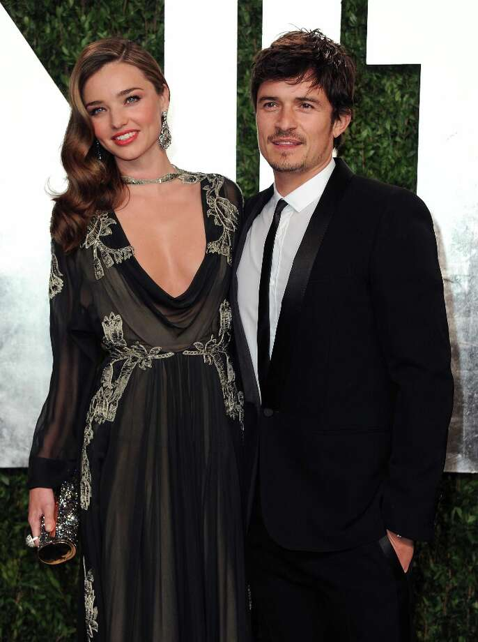 Model Miranda Kerr, left, and actor Orlando Bloomarrive at the 2013 Vanity Fair Oscars Viewing and After Party on Sunday, Feb. 24 2013 at the Sunset Plaza Hotel in West Hollywood, Calif. (Photo by Jordan Strauss/Invision/AP) Photo: Jordan Strauss, Associated Press / Invision