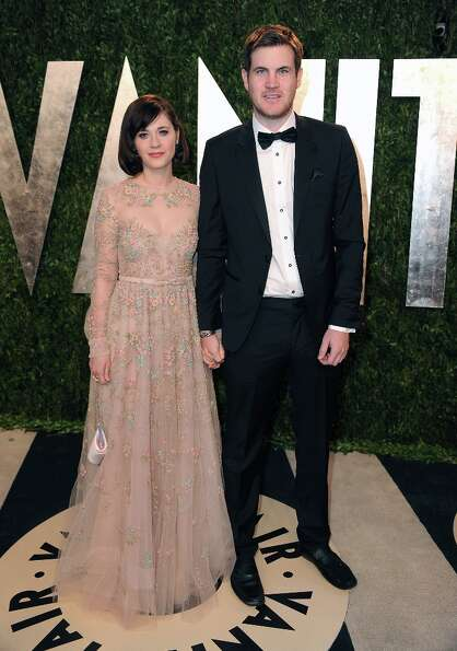 Actress Zooey Deschanel and writer Jamie Linden arrive at the 2013 Vanity Fair Oscars Viewing and Af